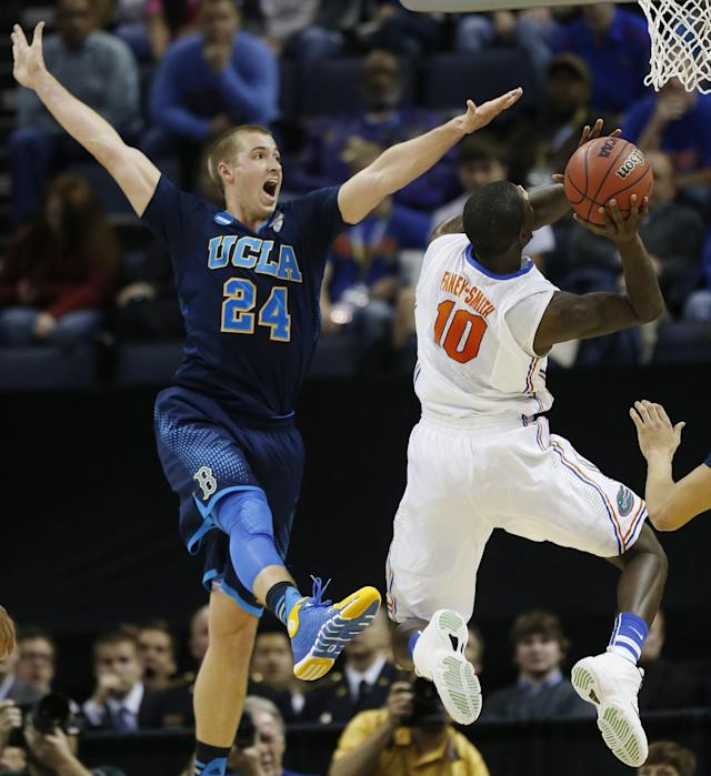 Florida forward Dorian Finney-Smith (10) shoots against UCLA forward Travis Wear (24) during the first half in a regional semifinal game at the NCAA college basketball tournament, Thursday, March 27, 2014, in Memphis, Tenn. (AP Photo/John Bazemore)