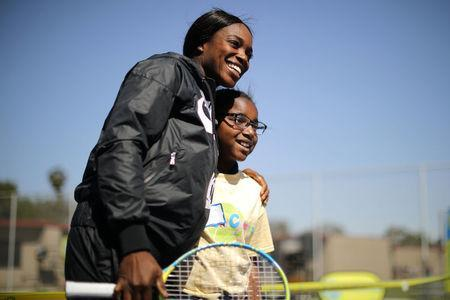 U.S. Open Champion Sloane Stephens (L) teaches tennis to 400 elementary students at a workshop in Compton, California, U.S. April 12, 2018. REUTERS/Lucy Nicholson