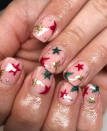 "<p><a href=""https://www.instagram.com/nailsby__emilyrachael/"" rel=""nofollow noopener"" target=""_blank"" data-ylk=""slk:Freehand nail artist Emily Rachael"" class=""link rapid-noclick-resp"">Freehand nail artist Emily Rachael</a> uses gold, silver, red and green colors to give a festive look to this starry manicure made simple by nail stickers.</p><p><a class=""link rapid-noclick-resp"" href=""https://go.redirectingat.com?id=74968X1596630&url=https%3A%2F%2Fwww.etsy.com%2Flisting%2F700707044%2Fnail-art-3d-glitter-stickers-decals&sref=https%3A%2F%2Fwww.oprahmag.com%2Fbeauty%2Fg34113691%2Fchristmas-nail-ideas%2F"" rel=""nofollow noopener"" target=""_blank"" data-ylk=""slk:SHOP NAIL STICKERS"">SHOP NAIL STICKERS</a></p>"