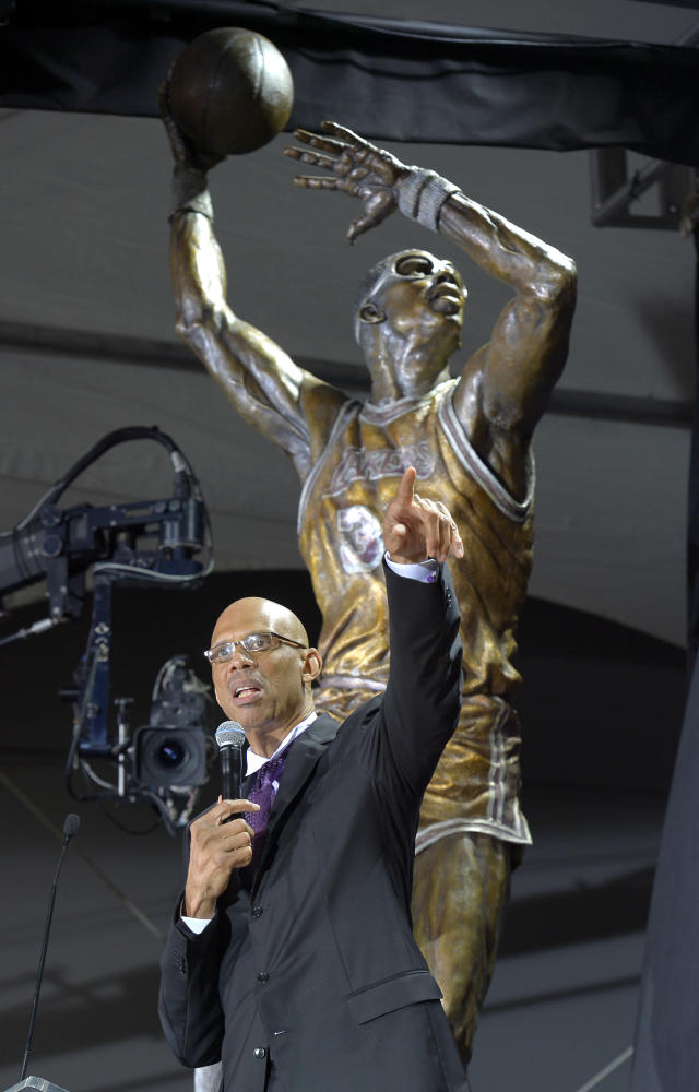 Former Los Angeles Lakers center Kareem Abdul-Jabbar speaks after unveiling a statue of himself in front of Staples Center, Friday, Nov. 16, 2012, in Los Angeles. (AP Photo/Mark J. Terrill)