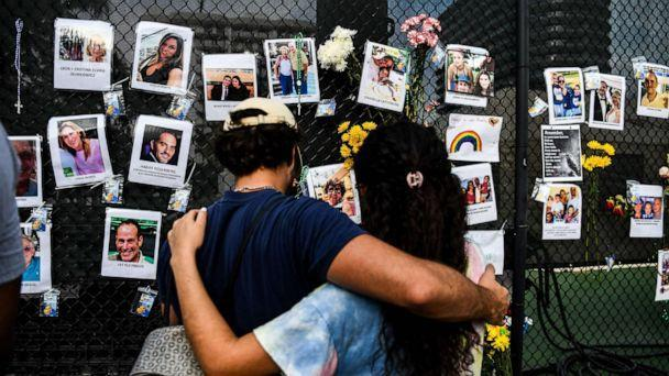 PHOTO: People visit the makeshift memorial for the victims of the building collapse, near the site of the accident in Surfside, Fla., June 27, 2021. (Chandan Khanna/AFP via Getty Images)