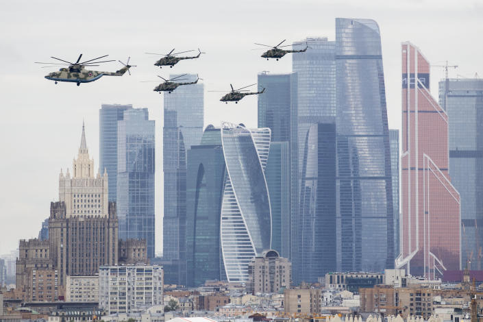 Russian military helicopters fly over Moscow's City skyscrapers and empty streets to mark the 75th anniversary of the Nazi defeat in World War II in Moscow, Russia, Saturday, May 9, 2020. A massive Victory Day parade on Red Square was cancelled due to the coronavirus outbreak, but Russia marked the holiday with the flyby. (AP Photo/Denis Tyrin)