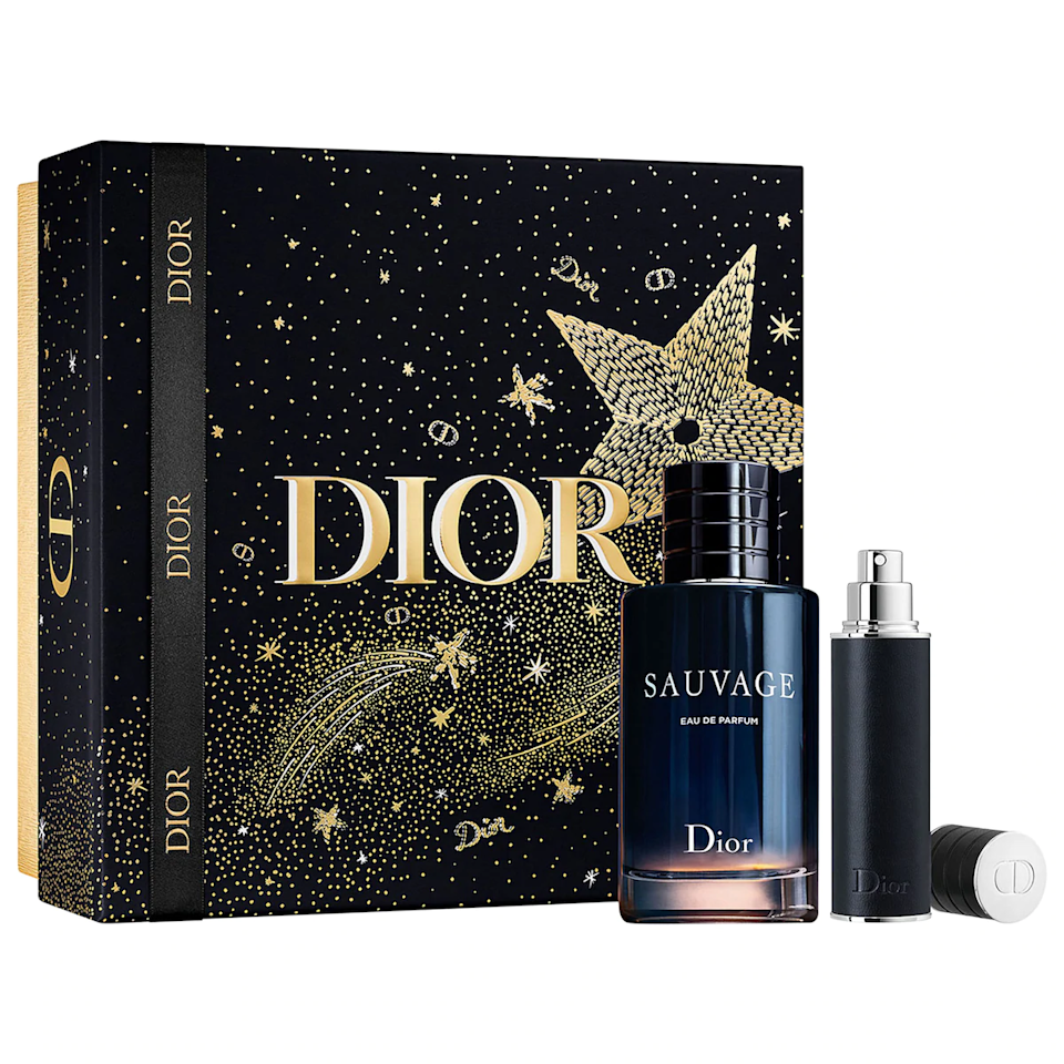 """<h3><a href=""""https://www.sephora.com/product/dior-sauvage-eau-de-parfum-set-P464224"""" rel=""""nofollow noopener"""" target=""""_blank"""" data-ylk=""""slk:Dior Sauvage Eau de Perfum Set"""" class=""""link rapid-noclick-resp"""">Dior Sauvage Eau de Perfum Set </a></h3><br>If your dad doesn't go anywhere — not even Trader Joe's — without his signature scent, then he'll <em>love</em> this luxe Dior Sauvage gift set filled with two bottles of crisp cologne. (One for home, one for business trips.)<br><br><strong>Dior</strong> Sauvage Eau de Parfum Set, $, available at <a href=""""https://go.skimresources.com/?id=30283X879131&url=https%3A%2F%2Fwww.sephora.com%2Fproduct%2Fdior-sauvage-eau-de-parfum-set-P464224"""" rel=""""nofollow noopener"""" target=""""_blank"""" data-ylk=""""slk:Sephora"""" class=""""link rapid-noclick-resp"""">Sephora</a>"""