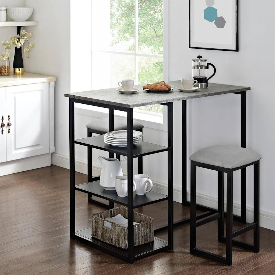 <p>You can display your most aesthetic dinnerware on the shelves of this <span>Mainstays 3-Piece Metal Pub Set </span> ($169). It is great for small apartments. Plus, the extra storage is a game-changer.</p>