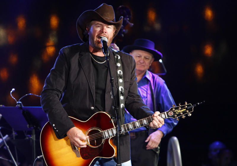 FILE - In this Oct. 30, 2012, file photo Toby Keith performs at the 60th Annual BMI Country Awards on in Nashville, Tenn. Authorities say a man attending a Toby Keith concert in New Jersey climbed a fence into a nearby housing complex, waved a Confederate flag and shouted racial slurs at residents. Thirty-three-year-old Darren Walp, of Ridley Park, Pa., was arrested Saturday, June 22, 2013, in the crowd at the Susquehanna Bank Center in Camden. (Photo by Wade Payne/Invision/AP, File)