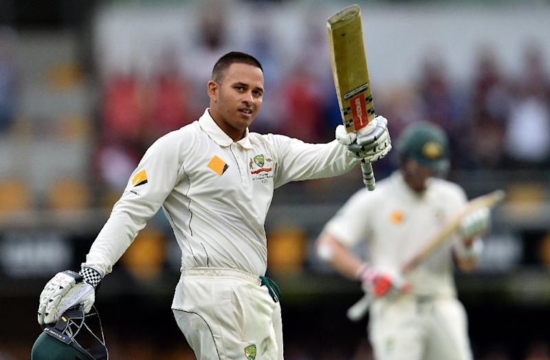 Australia's batsman Usman Khawaja celebrates his first Test century during day one of the first Test against New Zealand in Brisbane on November 5, 2015 (AFP Photo/Saeed Khan)