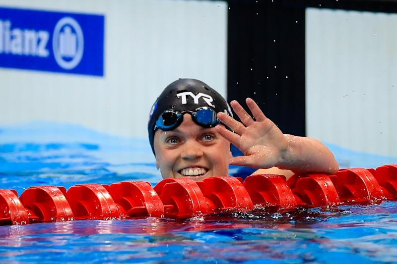Ellie Simmonds waves to the crowd at the London Aquatics Centre after winning bronze in the 100m breaststroke on the final night of racing