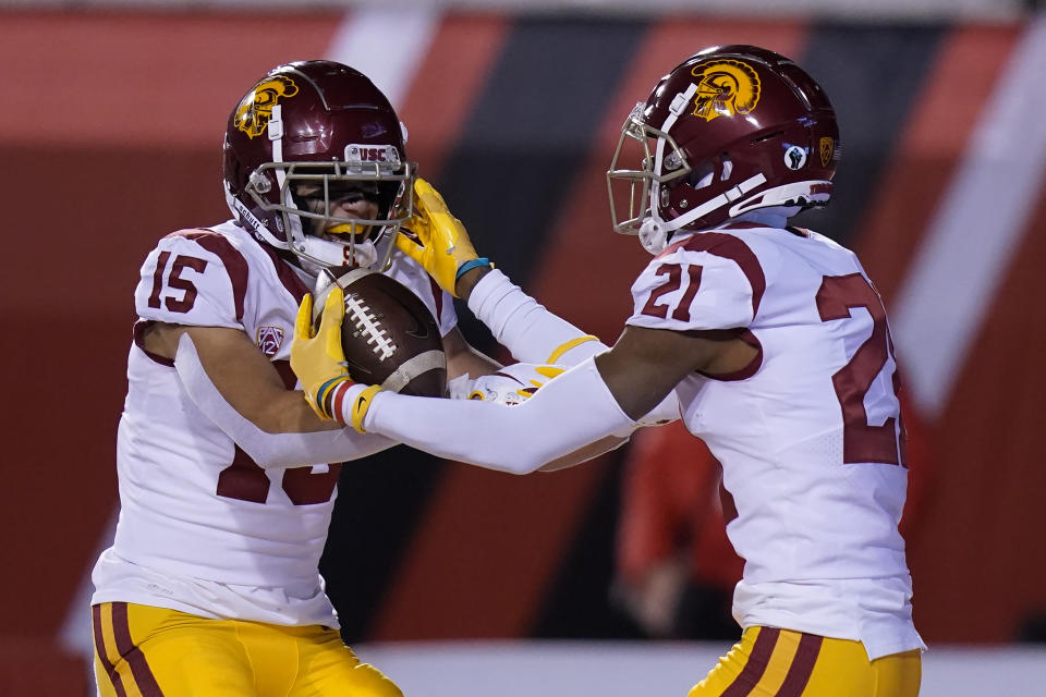 Southern California's Tyler Vaughns (21) celebrates his touchdown against Utah with Drake London (15) during the first half of an NCAA college football game Saturday, Nov. 21, 2020, in Salt Lake City. (AP Photo/Rick Bowmer)