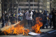 A demonstrators sets fire to a barricade during rioting as a 24-hour strike is called, on March 29, 2012 in Barcelona, Spain. Spanish workers staged a general strike to protest the government's latest labour reforms, which are designed to help Spain lower its deficit within EU limits. (Photo by David Ramos/Getty Images)