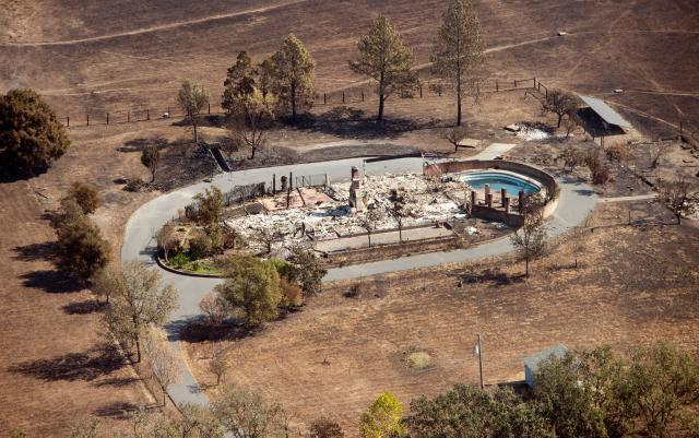 <p>An aerial view shows a burned property in Santa Rosa, Calif., on Oct. 12, 2017. (Photo: Josh Edelson/AFP/Getty Images) </p>