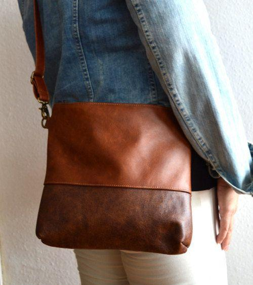 """Get it <a href=""""https://www.etsy.com/listing/244977406/leather-crossbody-bag-medium-brown?ref=cyber_subcategory"""" target=""""_blank"""">here</a>."""