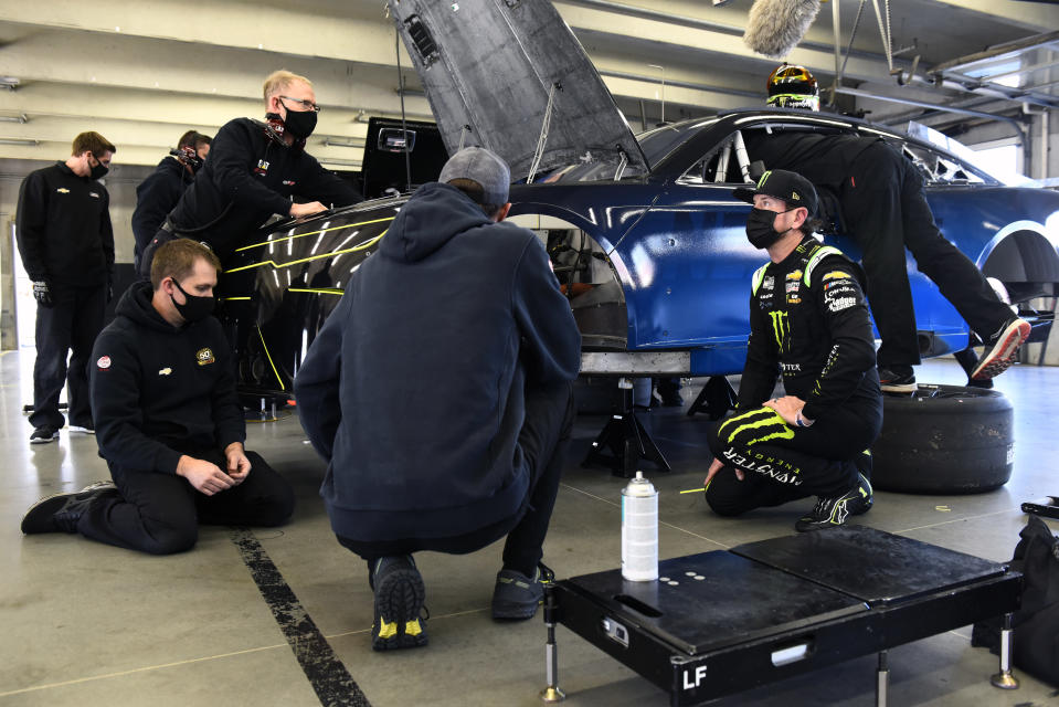 CONCORD, NORTH CAROLINA - NOVEMBER 16: Kurt Busch speaks with team members in the garage area during the NASCAR Cup Series test at Charlotte Motor Speedway on November 16, 2020 in Concord, North Carolina. (Photo by Jared C. Tilton/Getty Images) | Getty Images