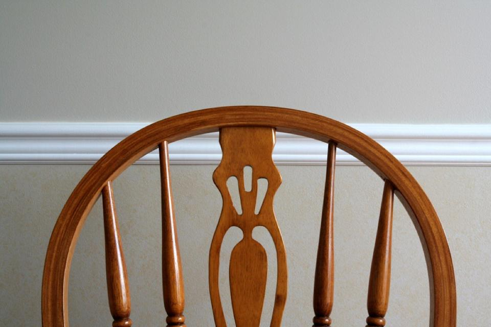 wooden chair against chair rail molding, vintage home upgrades