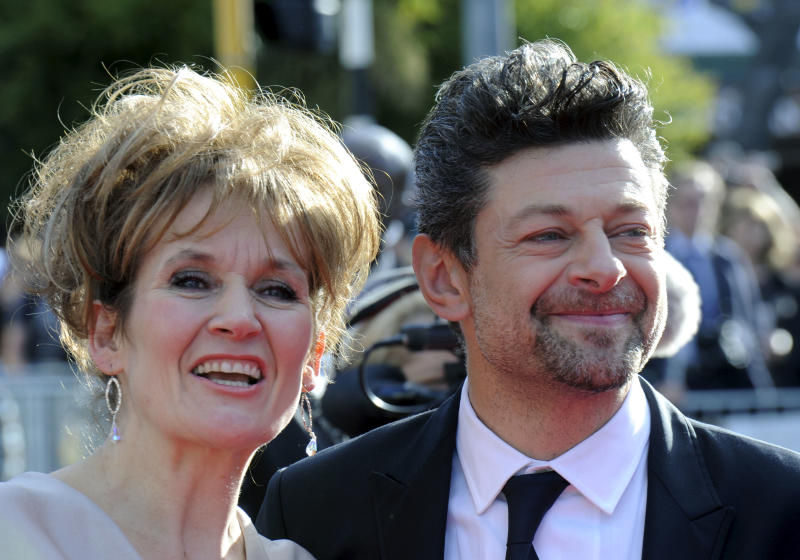 """Cast member Andy Serkis, right, and his wife Loraine Ashbourne pose on the red carpet at the premiere of """"The Hobbit: An Unexpected Journey,"""" at the Embassy Theatre, in Wellington, New Zealand, Wednesday, Nov. 28, 2012. (AP Photo/SNPA, Ross Setford) NEW ZEALAND OUT"""
