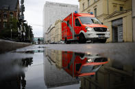 A rescue vehicle drives in front of the central building of the Charite hospital where the Russian opposition leader Alexei Navalny is being treated, in Berlin, Germany, Wednesday, Sept. 2, 2020. Russian opposition leader Alexei Navalny was the victim of an attack and poisoned with the Soviet-era nerve agent Novichok, the German government said Wednesday, Sept. 2, 2020 citing new test results. (AP Photo/Markus Schreiber)