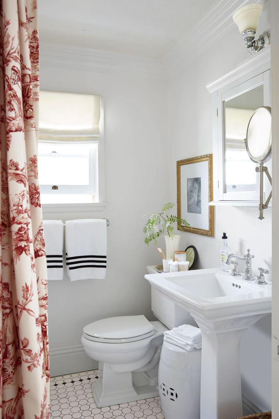<p>Janet and Larry Korff took out the bulky bathroom door and replaced it with a stylish curtain. The upgrade makes the space feel far less cramped, but it still ensures privacy.</p>