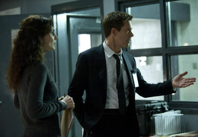 "Ryan Hardy (Kevin Bacon) and Agent Parker (Annie Parisse) look for Joe Carroll's followers in the ""Guilt"" episode of ""The Following."""