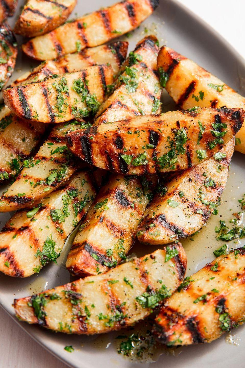 "<p>These potatoes are the perfect summer side. Throw 'em on the grill next to your burgers for a smokey, summer take on burgers & chips. Take it from us, though, and don't skip step 1. It's pretty much impossible to get potatoes tender and cooked through on the grill alone; parboiling the potatoes guarantees creamy centres and crisp, charred outsides.</p><p>Get the <a href=""https://www.delish.com/uk/cooking/recipes/a28794676/best-grilled-potatoes-recipe/"" rel=""nofollow noopener"" target=""_blank"" data-ylk=""slk:Grilled Potatoes"" class=""link rapid-noclick-resp"">Grilled Potatoes</a> recipe.</p>"