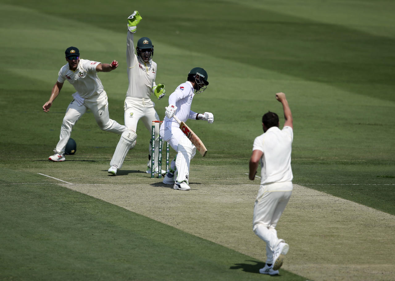 Australia's players appeal the dismissal of Pakistan's Fakhar Zaman during their test match in Abu Dhabi, United Arab Emirates, Tuesday, Oct. 16, 2018. (AP Photo/Kamran Jebreili)