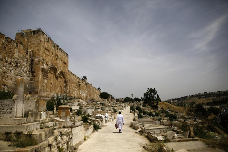 A man walks along a path near the Golden Gate, in Jerusalem's Old City. (Photo: Nir Elias/Reuters)