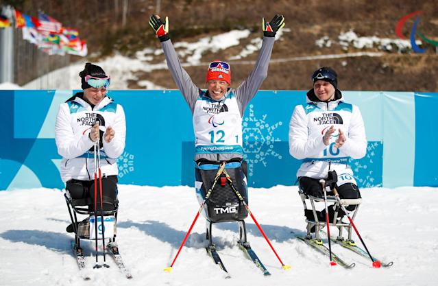 Biathlon - Pyeongchang 2018 Winter Paralympics - Women's 10km - Sitting - Alpensia Biathlon Centre - Pyeongchang, South Korea - March 13, 2018 - Gold medallist Andrea Eskau (12) of Germany, silver medallist Marta Zainullina (9), an Olympic Athlete from Russia, and bronze medallist Irina Guliaeva (10), an Olympic Athlete from Russia. REUTERS/Carl Recine