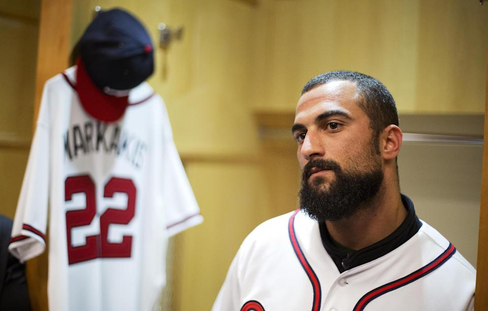 Atlanta Braves newest outfielder Nick Markakis speaks with reporters in the baseball team's clubhouse, Friday, Dec. 5, 2014, in Atlanta. Markakis signed a four-year contract with the team on Wednesday. (AP Photo/David Goldman)
