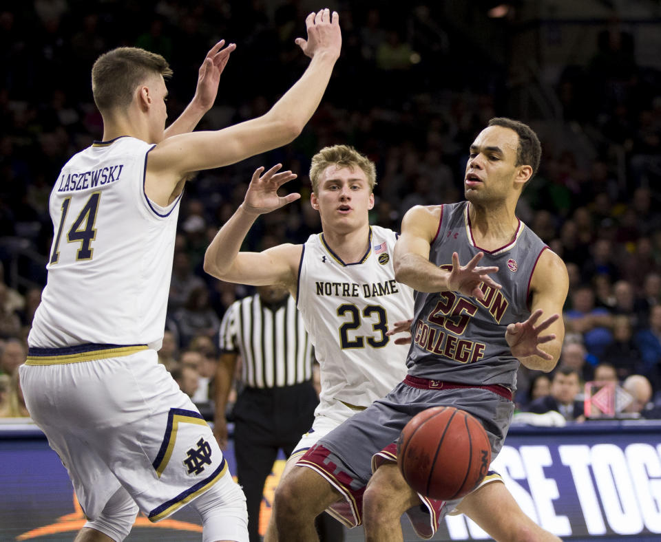 Boston College's Jordan Chatman (25) passes the ball in front of Notre Dame's Nate Laszewski (14) and Dane Goodwin (23) during the first half of an NCAA college basketball game Saturday, Jan. 12, 2019, in South Bend, Ind. (AP Photo/Robert Franklin)
