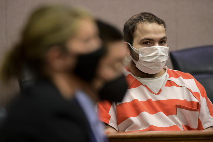 Ahmad Al Aliwi Alissa appears in a Boulder County District courtroom in Boulder, Colo., on Tuesday, May 25, 2021. The 22-year-old man accused of fatally shooting 10 people at a Colorado supermarket appeared in court Tuesday for a hearing to discuss what will happen next in the case. The status hearing will be only the second court appearance for Ahmad Al Aliwi Alissa since the March 22 attack in Boulder. (Matthew Jonas/Boulder Daily Camera via AP, Pool)