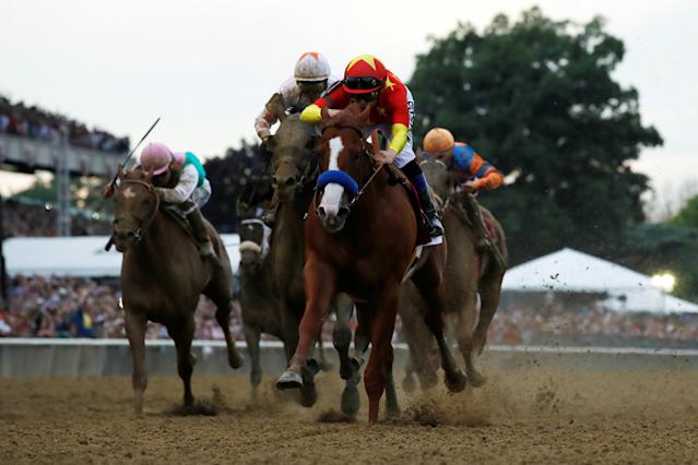 Justify with jockey Mike Smith aboard wins the 150th running of the Belmont Stakes, the third leg of the Triple Crown of Thoroughbred Racing at Belmont Park in Elmont, New York, U.S., June 9, 2018. REUTERS/Mike Segar