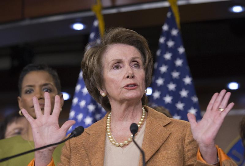 In this Feb. 28, 2013, photo, House Minority Leader Nancy Pelosi of Calif., joined by fellow House Democratic women, gestures during a news conference on Capitol Hill in Washington, to talk about the impending automatic spending cuts that will most likely take effect late Friday, March 1. (AP Photo/J. Scott Applewhite)