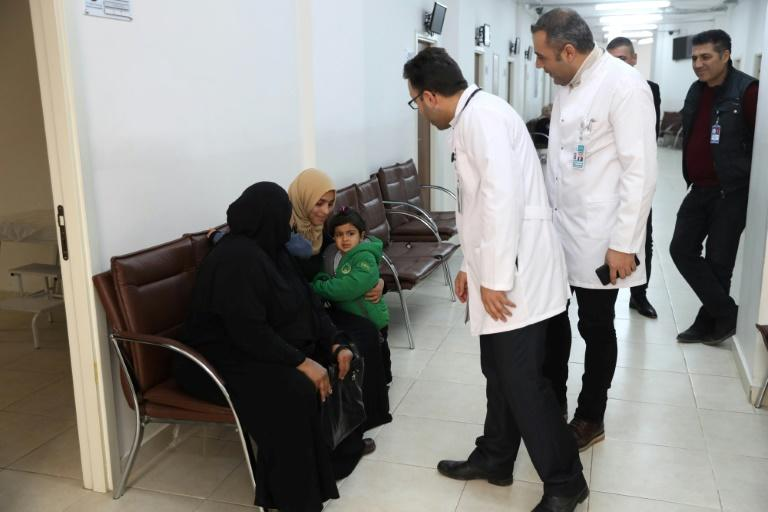 Safa al-Hussein brings her four-year-old daughter, Ahed, who was injured in an attack on the northern Syrian city of Raqa, to be treated by exiled Syrian doctors at a healthcare centre in the Turkish capital, Ankara