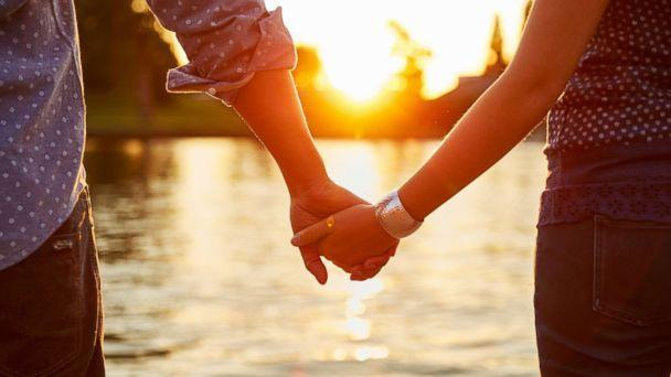 PHOTO: A couple holds hands by the river in this undated stock photo. (STOCK PHOTO/Getty Images)