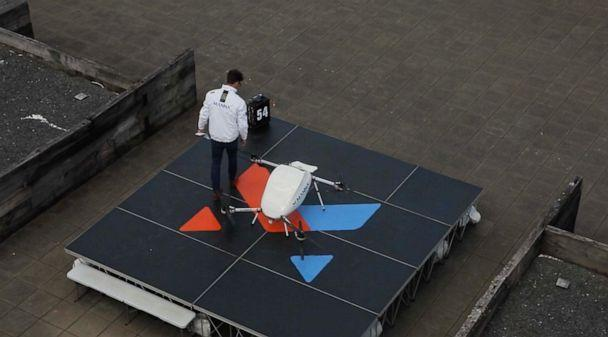 PHOTO: A Manna technician inspects and loads a delivery drone on a launchpad in Oranmore. (Patrick Reevell/ABC News)
