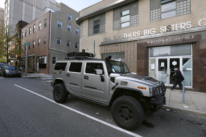 A parking violation envelope is affixed to the windshield of a Hummer vehicle parked near the Pennsylvania Convention Center where votes are being counted, Friday, Nov. 6, 2020, in Philadelphia. Police said Friday they arrested two men Thursday for not having permits to carry firearms near the center. Police said the men acknowledged that the Hummer spotted by officers near the center was was their vehicle. (AP Photo/Rebecca Blackwell)