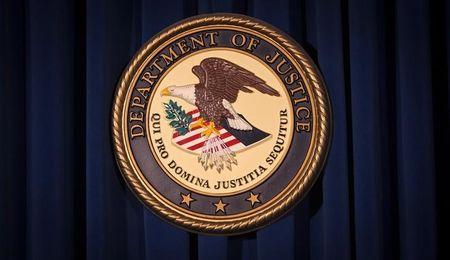 FILE PHOTO: The DOJ logo is pictured on a wall after a news conference in New York