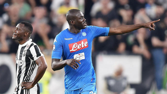 Napoli's kaliodou Koulibaly, right, celebrates after scoring during a Serie A soccer match between Juventus and Napoli at the Allianz Stadium in Turin, Italy, Sunday, April 22, 2018. (Alessandro Di Marco/ANSA via AP)