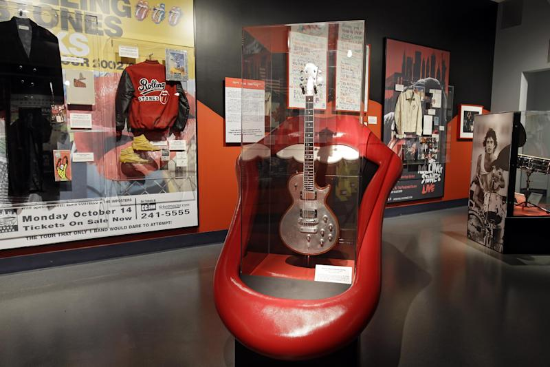 "In this May 21, 2013 photo, Rolling Stones memorabilia is displayed at the Rock and Roll Hall of Fame in Cleveland. The new exhibit ""Rolling Stones 50 Years of Satisfaction"" opens Friday. (AP Photo/Mark Duncan)"