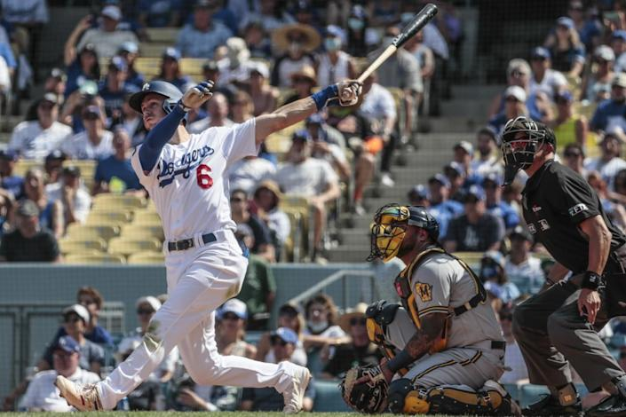 Dodgers shortstop Trea Turner hits a grand slam in the fifth inning against the Milwaukee Brewers on Sunday.