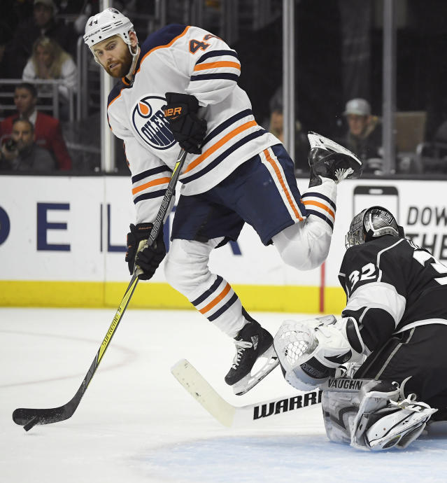 Edmonton Oilers right wing Zack Kassian, left, jumps as he tries to score on Los Angeles Kings goaltender Jonathan Quick during the third period of an NHL hockey game Saturday, Feb. 24, 2018, in Los Angeles. The Oilers won 4-3. (AP Photo/Mark J. Terrill)