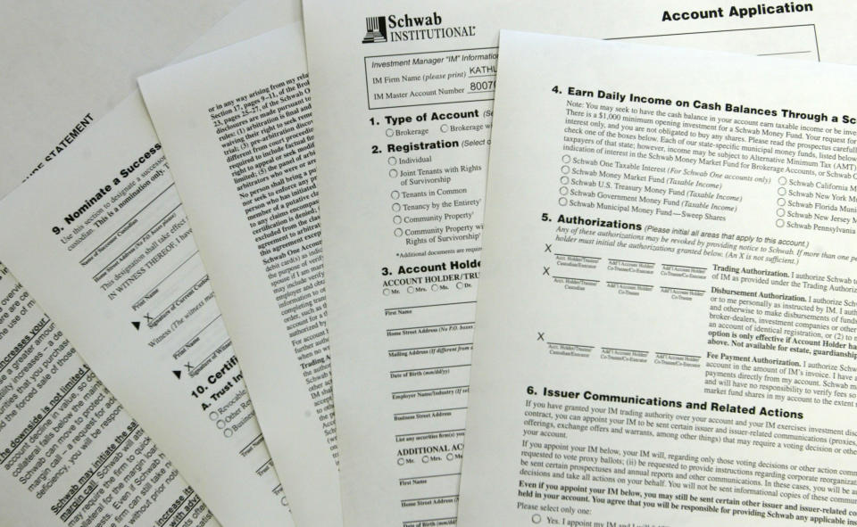 A Schwab Institutional brokerage account application form from the Enrichment Group is shown in Miami. (Photo: Joe Raedle/Getty Images)