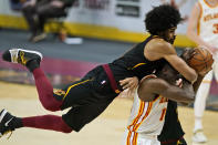 Cleveland Cavaliers' Jarrett Allen, top, fouls Atlanta Hawks' Clint Capela in the second half of an NBA basketball game, Tuesday, Feb. 23, 2021, in Cleveland. The Cavaliers won 112-111. (AP Photo/Tony Dejak)
