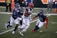 Cincinnati Bengals' Tyler Boyd (83) is tackled by Tennessee Titans' Chris Jackson (35) during the second half of an NFL football game, Sunday, Nov. 1, 2020, in Cincinnati. (AP Photo/Gary Landers)