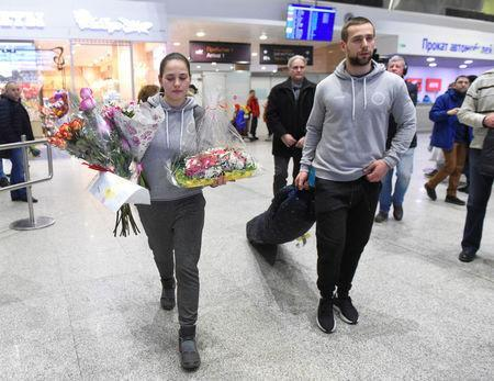 Russian Olympic curlers Alexander Krushelnitsky and his wife Anastasia Bryzgalova return from the Pyeongchang 2018 Winter Olympics, at Pulkovo airport outside St. Petersburg, Russia February 22, 2018. REUTERS/Sergei Nikolaev
