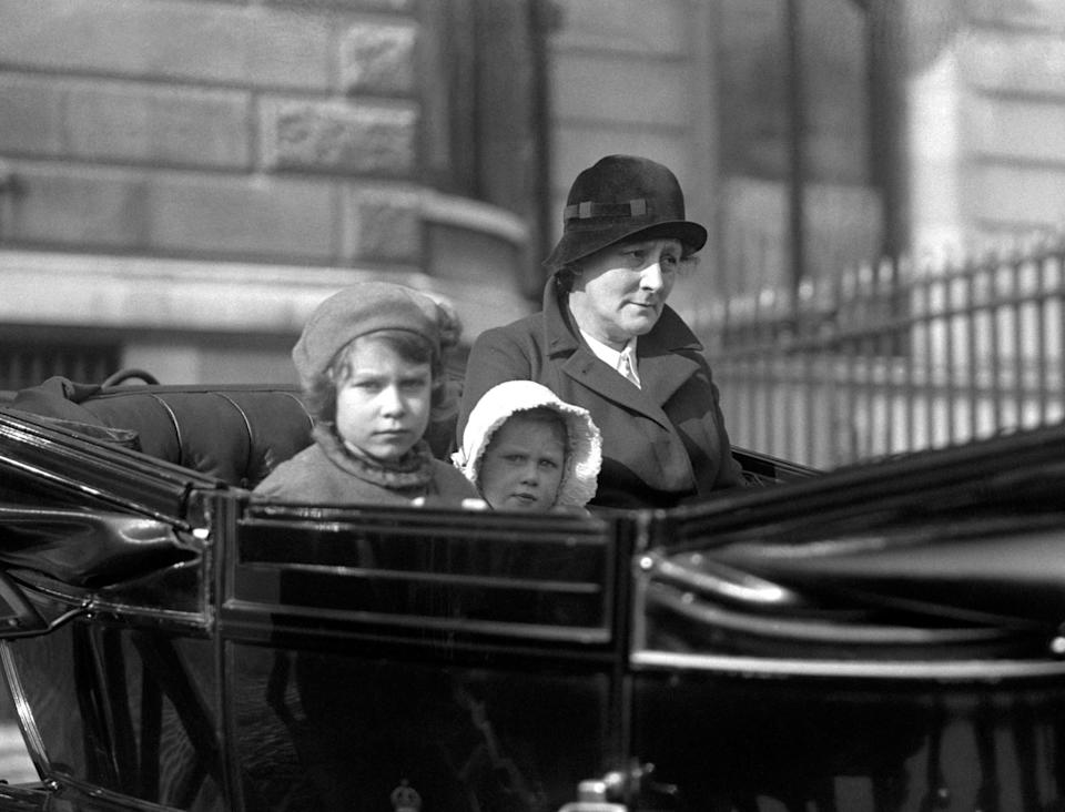 <p>Princess Elizabeth and her sister Princess Margaret Rose go out for a ride with their nanny in their horse-drawn carriage (PA Archive) </p>