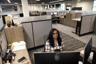Shobha Surya, associate manager for projects and sales operations of Ajinomoto, a global food and pharmaceutical company, works in a shared office space in Itasca, Ill., Monday, June 7, 2021. Surya said she feels energized by the light pouring in from skylights at the new headquarters, adding that she missed her colleagues and is thrilled to be back in-person. (AP Photo/Shafkat Anowar)