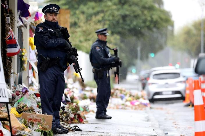 Armed police officers stand guard outside one of the mosques where some 50 people were killed by a self-avowed white supremacist gunman on March 15 in Christchurch (AFP Photo/Sanka VIDANAGAMA)