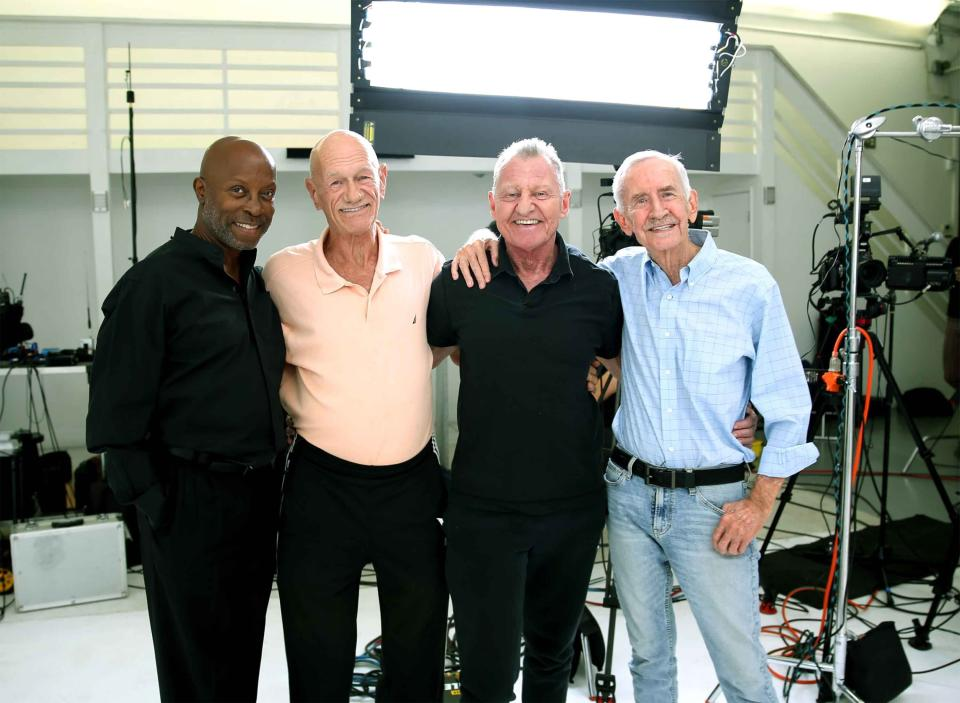 This photo shows Jessay Martin, 68, from left, Robert Reeves, 78, Michael Peterson, 65, and William Lyons, 77, in Cathedral City, Calif., in November 2020. The four friends, known as the Old Gays, are among a growing number of seniors making names for themselves on social media. (Ryan Yezak via AP)
