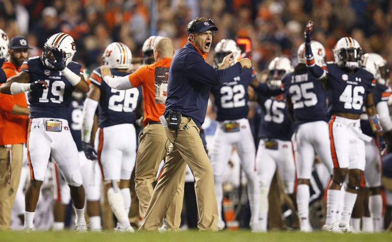 Auburn head coach Gus Malzahn reacts as his players celebrate their win against Alabama during the second half of the Iron Bowl NCAA college football game, Saturday, Nov. 25, 2017, in Auburn, Ala. Auburn won 26-14. (AP)