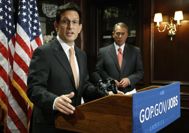 U.S. House Majority Leader Eric Cantor (R-VA) (L) and House Speaker John Boehner (R-OH) hold a news conference after a Republican Party caucus meeting on Capitol Hill in Washington in this file photo taken May 20, 2014. Cantor will step down as House of Representatives Republican leader effective July 31 following his defeat in a primary on Tuesday, the Washington Post reported on Wednesday, citing three Republicans familiar with his plans. REUTERS/Jonathan Ernst/Files (UNITED STATES - Tags: POLITICS)
