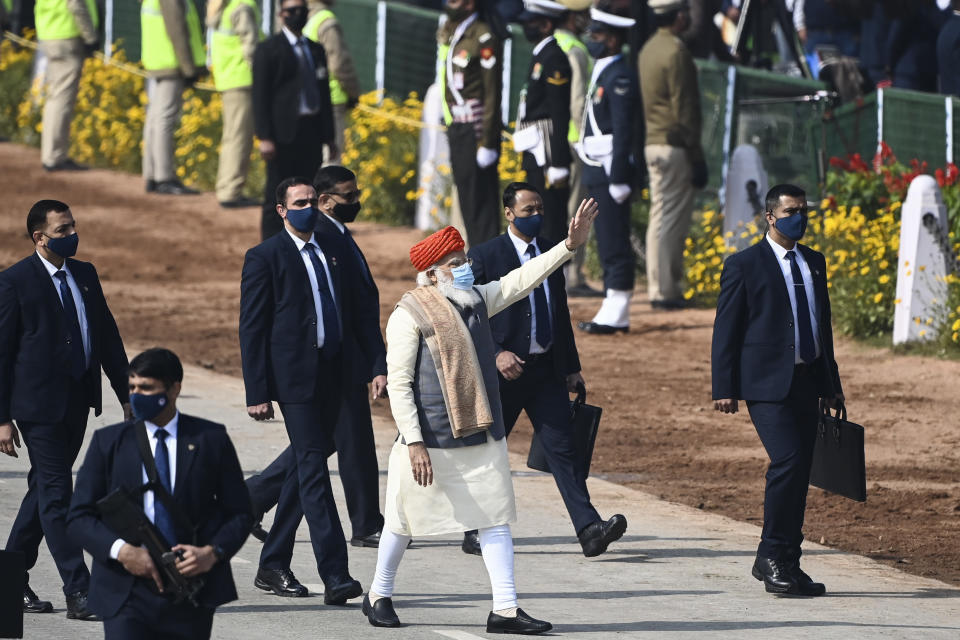 India's Prime Minister Narendra Modi (C) waves as he leaves after attending the Republic Day parade in New Delhi on January 26, 2021. (Photo by Jewel SAMAD / AFP) (Photo by JEWEL SAMAD/AFP via Getty Images)
